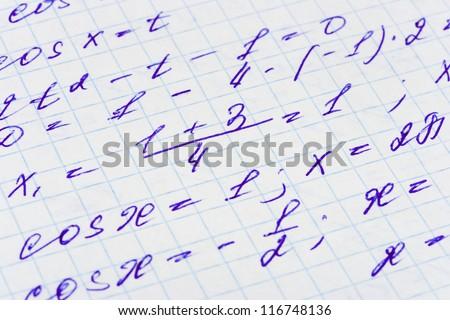 Mathematics formula on paper - abstract education background - stock photo