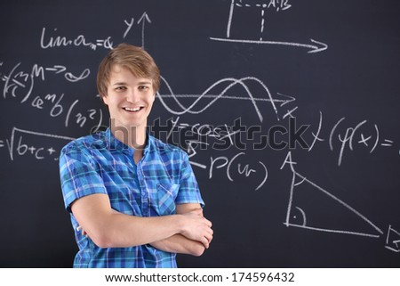 Mathematics, physics, chemistry-student at the blackboard . Portrait of a student at the blackboard background with patterns - stock photo