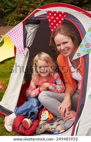 Mather And Daughter Enjoying Camping Holiday On Campsite  - stock photo