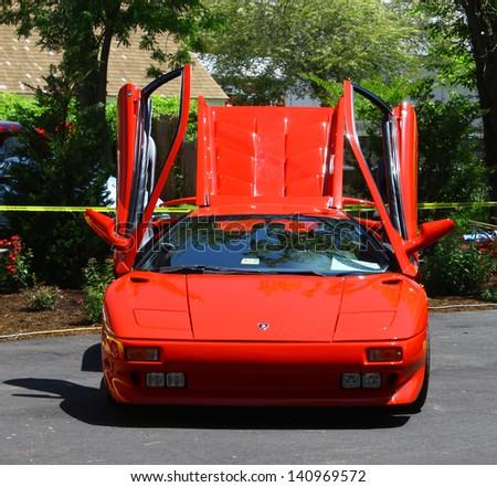"MATHEWS, VA- JUNE 01:A red Ferrari in the Annual: Vintage TV's ""Chasing Pavement Vintage Automotive Festival"" in Mathews, Virginia on June 01, 2013 - stock photo"