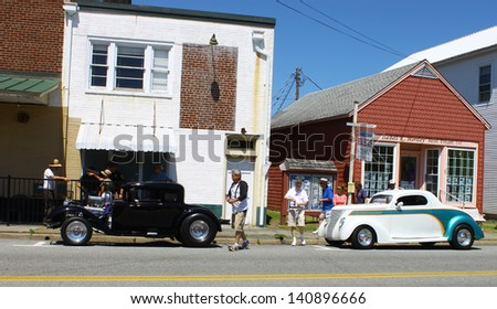 "MATHEWS, VA- JUNE 01:Two old Hotrods in the Annual: Vintage TV's ""Chasing Pavement Vintage Automotive Festival"" in Mathews, Virginia on June 01, 2013 - stock photo"
