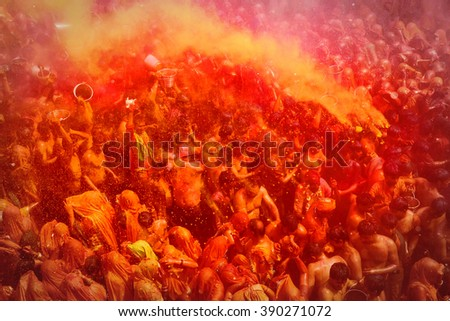 MATHURA,INDIA - 7/03/2015 : Indian devotees dance in colored water at the end of Holi celebrations, the Hindu festival of colors at the Baldev Temple - stock photo