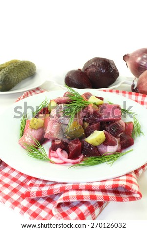 Matie salad with beetroot, onions and pickles - stock photo