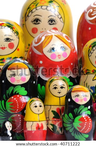 matreshka doll isolated on white Matreshkas Flash Mob - stock photo