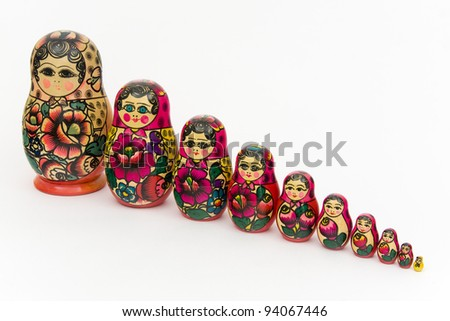 Matryoshka, a Russian wooden doll on a white background - stock photo