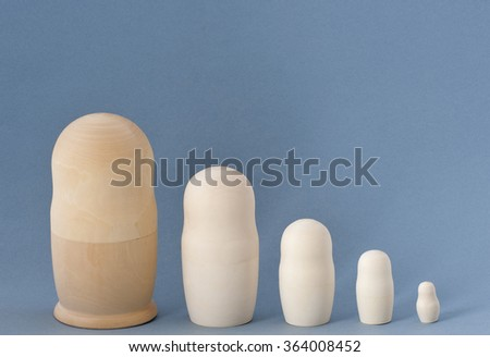 Matryoshka (nesting doll). The base of the birch for painting. - stock photo