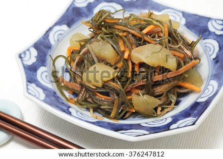 Matsumaezuke, pickled kombu, dried squid, carrot and herring roe with soy sauce  - stock photo