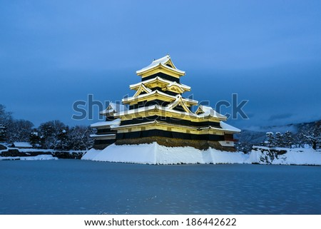 Matsumoto Castle in Winter at Twilight Scene on February 2014, Heavy snowfall in the past 120 years of Japan.