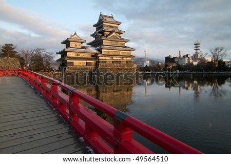 Matsumoto castle, view from the bridge overlooking Matsumoto castle with the city in background - stock photo