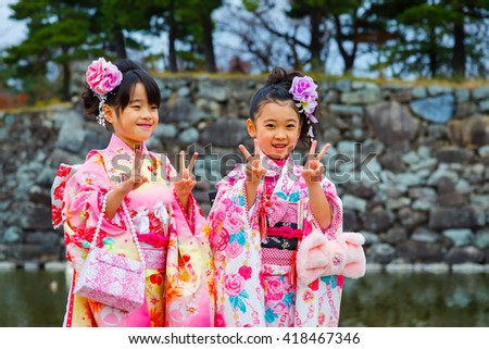 MATSUMOTO, JAPAN - NOVEMBER 21, 2015: Children at Atsuta shrine in a Traditional rite of passage and festival day in held for 3 and 7-year-old girls and 3 and 5-year-old boys - stock photo