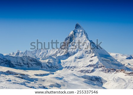 Matterhorn peak in winter sunny day - stock photo