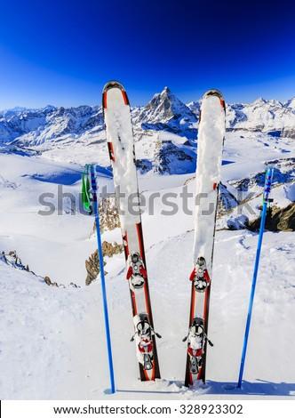 Matterhorn, Switzerland, winter season - ski equipments on ski run - stock photo