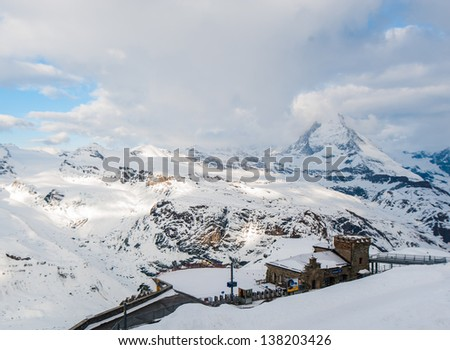 Matterhorn view with station cloud and blue sky