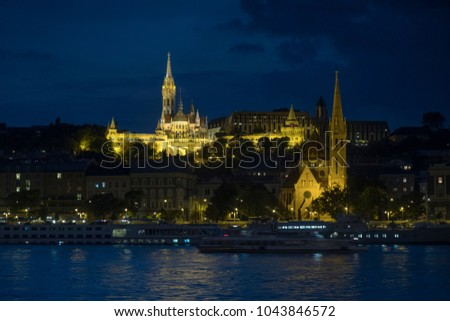 Matthias Church and River Danube lit up in the twilight of a September evening