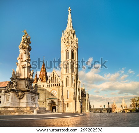 Matthias church and Statue of Holy Trinity in Budapest, Hungary late afternoon - stock photo