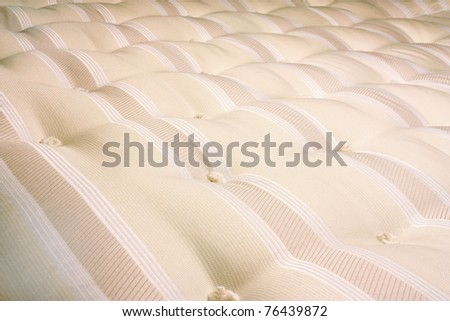 mattress for a bed close up of hand tufted buttons - stock photo