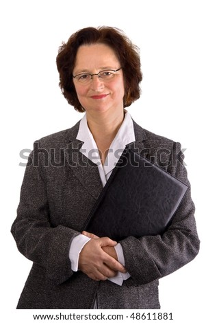 Mature adult businesswoman in a grey suit holding a folder