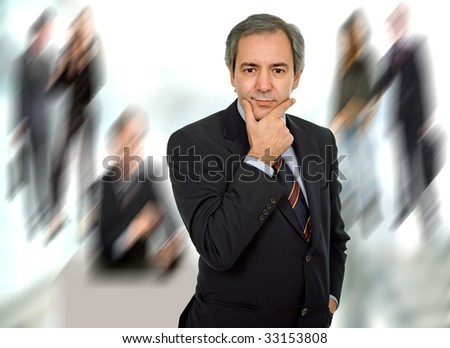 mature adult executive man standing alone thinking