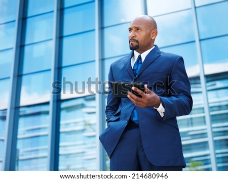 mature african american businessman using tablet - stock photo