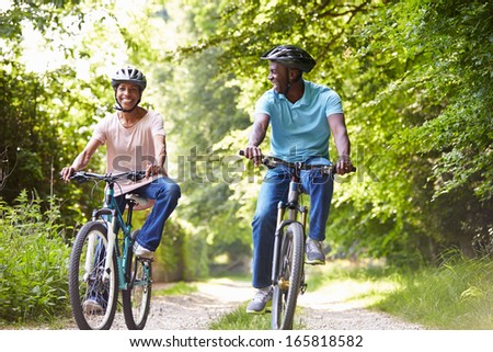 Mature African American Couple On Cycle Ride In Countryside - stock photo