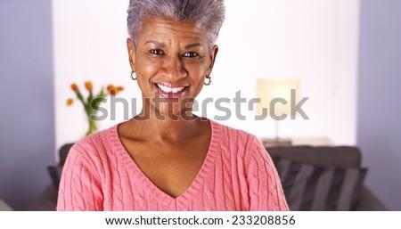 Mature African woman looking at camera - stock photo