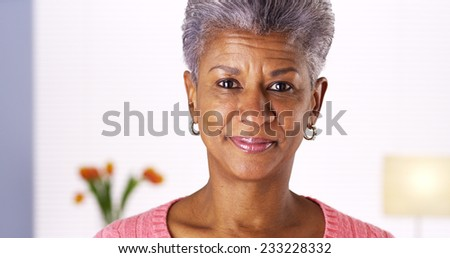 Mature African woman smiling at camera - stock photo