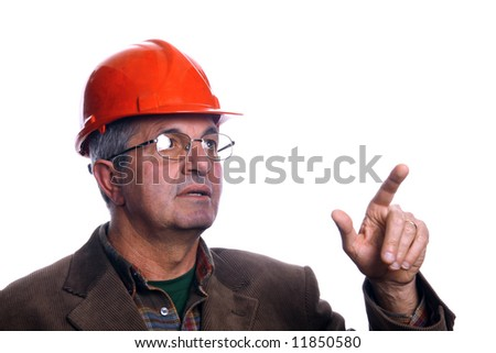 mature architect pointing up - stock photo