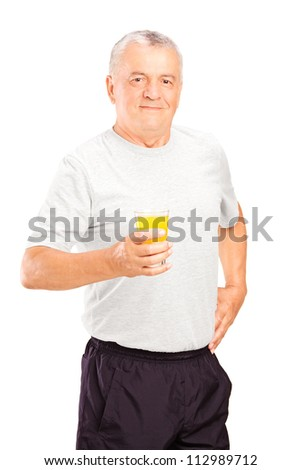 Mature athlete holding a glass of orange juice, refreshing after an exercise, isolated on white background - stock photo