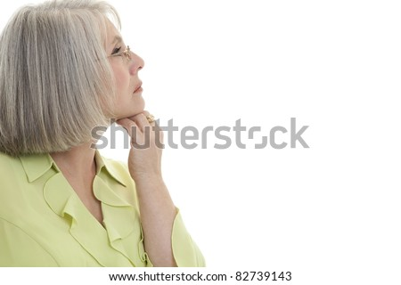 Mature, attractive Caucasian woman looking off into the distance. - stock photo
