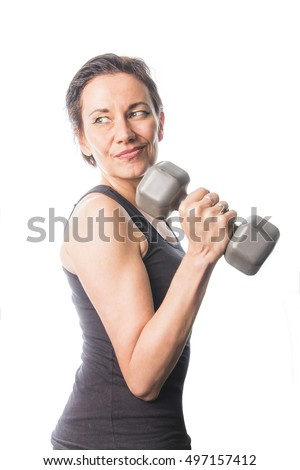 Mature brunette woman lifting weights, keeping her shape and performing regular daily exercise