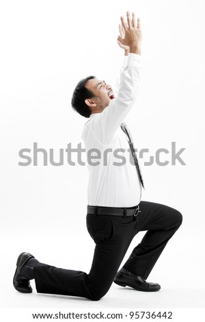 Mature business man begging, full length portrait isolated on white.