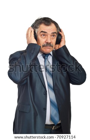 Mature business man listening music in headphones and relaxing isolated on white background