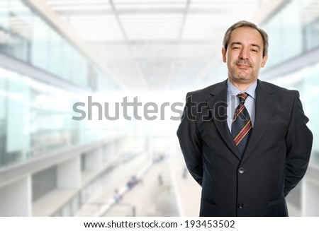 mature business man portrait at the office - stock photo