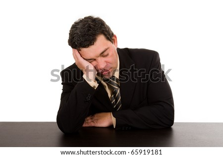 mature business man sleeping on the desk. Isolated in white.