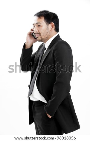 Mature business man talking on the phone over white background - stock photo