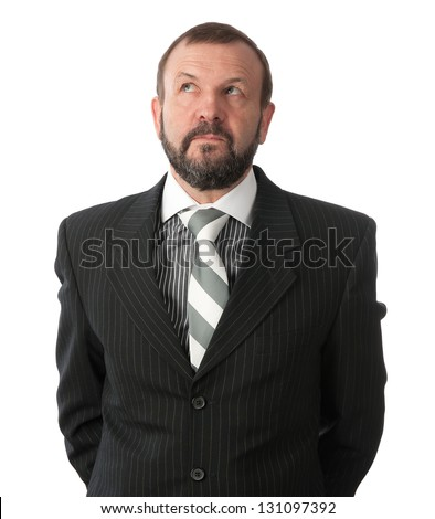 Mature business man thinking and looking up - stock photo