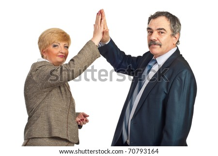 Mature business people giving high five and looking at camera isolated on white background