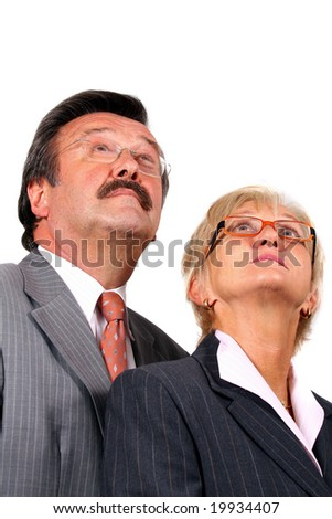 Mature business team A mature business couple looking up. Isolated over pure white.