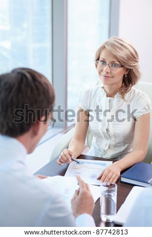 Mature business woman in office - stock photo