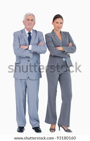Mature businessman and colleague with arms folded against a white background - stock photo