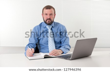 mature businessman at his office - stock photo
