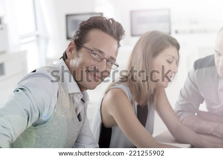 Mature businessman attending work meeting