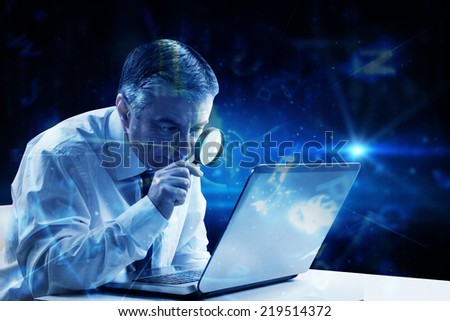 Mature businessman examining with magnifying glass against blue background with letters - stock photo