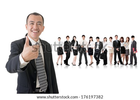 Mature businessman give you a gesture of excellent and standing in front of his team on studio white background. - stock photo