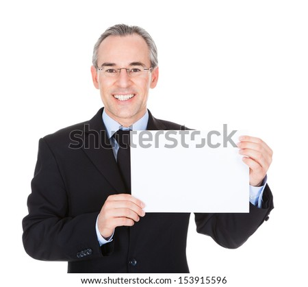 Mature Businessman Holding Blank Card Over White Background