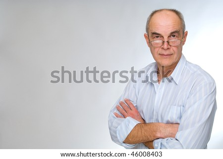 mature businessman in glasses - stock photo