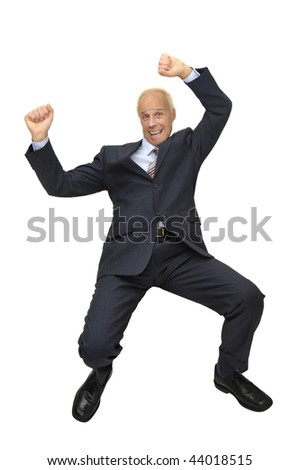 Mature businessman jumping isolated in white