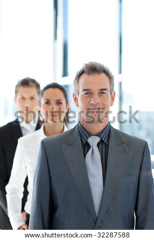 Mature businessman leading a business team in a line
