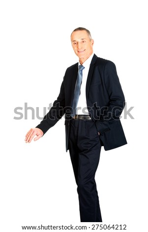 Mature businessman leaning on empty blank on the floor. - stock photo