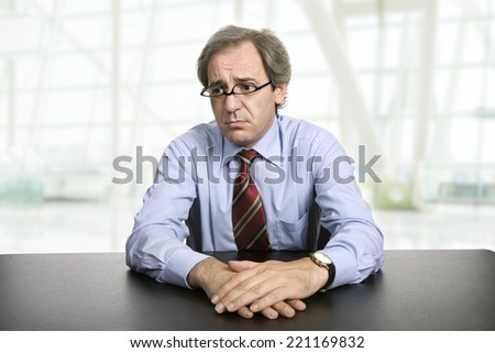mature businessman on a desk at the office - stock photo